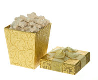 Gift Box full of Milk Bone Dog Treats. Gold Gift Box full of Miniature Milk Bone Dog Treats,  present for a dog Royalty Free Stock Images