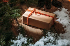 gift box and fur tree on wooden background Royalty Free Stock Image