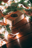 gift box and fur tree on wooden background Royalty Free Stock Photography