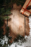 gift box and fur tree on wooden background Stock Photo