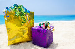 Gift box and gift bag on the beach - holiday concept Royalty Free Stock Image