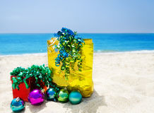 Gift box and gift bag on the beach - holiday concept Royalty Free Stock Photos