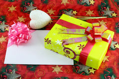 Gift box and gift card. On cristmas paper background Stock Images