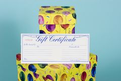 Gift Box with gift certificate. Two colorful gift boxes with balloon decoration with a gift certificate stock photo
