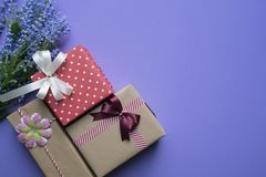 Gift box and gift shopping on purple background view from above Royalty Free Stock Image