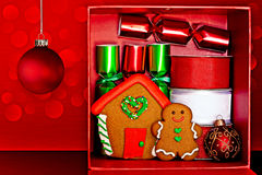 Gift Box, Gingerbread Man & House, Christmas Decor. Red Gift Box Filled With Gingerbread Man and Gingerbread House, Red & Green Party Favors, Decorative Red & Stock Image