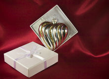 Gift box with a glass Christmas decoration Stock Photos