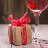 Gift box and glass of pink wine Royalty Free Stock Image