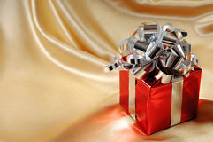 Gift Box on Gold Background Royalty Free Stock Image
