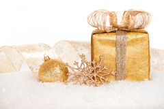 Gift box and gold Christmas decorations Stock Photography
