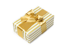 Gift box in gold duo tone with golden satin Stock Images
