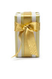 Gift box in gold duo tone with golden satin ribbon Royalty Free Stock Photo