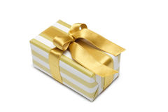 Gift box in gold duo tone with golden satin ribbon Stock Image