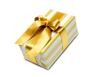 Gift box in gold duo tone with golden satin ribbon Royalty Free Stock Images