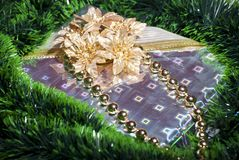 Gift box with gold flowers and ribbons Royalty Free Stock Photos