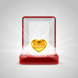 Gift box and gold heart in radiance Royalty Free Stock Images