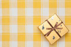 Gift box of gold Royalty Free Stock Photos