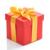 Gift box with gold ribbon Stock Image