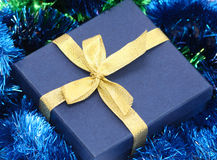 Gift box with gold ribbon Royalty Free Stock Photography