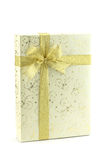 Gift box with gold ribbon bow Royalty Free Stock Photos