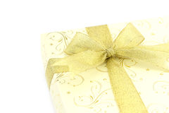 Gift box with gold ribbon bow Royalty Free Stock Images