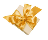 Gift box with gold ribbon and bow Royalty Free Stock Image