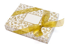 Gift box with gold ribbon and bow on white Stock Photography