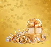 Gift box in gold wrapping paper Royalty Free Stock Photography