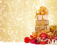 Gift box in gold wrapping paper Stock Image