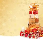 Gift box in gold wrapping paper Stock Photography