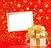 Gift box in gold wrapping paper Royalty Free Stock Photos