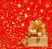 Gift box in gold wrapping paper Royalty Free Stock Images