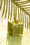 Gift box on golden Royalty Free Stock Photos
