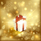 Gift box on golden background royalty free stock image