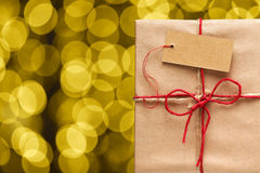 Gift box and golden blurred lights Stock Photography