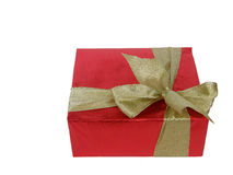 Gift box with a golden bow. Red rectangular gift box with a golden bow over white Stock Images