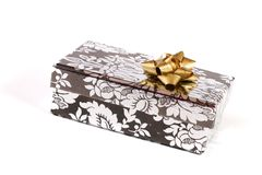 Gift box with golden bow Stock Photos