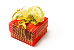 Gift box with golden bow. Red gift box on white background with golden bow Stock Photos