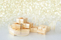 Gift box. With golden bow Background Glitter Stock Image