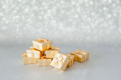 Gift box. With golden bow Background Glitter Royalty Free Stock Images