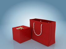 Gift box with golden bow and gift bag Stock Images