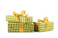 Gift box with golden bow isolated on white background Royalty Free Stock Image