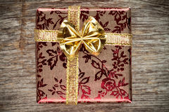 Gift box with golden bow Stock Photo