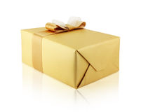 Gift box in golden paper Stock Photo