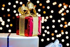 Gift box and golden ribbon Royalty Free Stock Photo