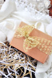 Gift Box with Golden Ribbon on Background Royalty Free Stock Photography