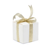 Gift box with golden ribbon bow on white Royalty Free Stock Image