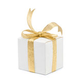 Gift box with golden ribbon bow on white Stock Photography