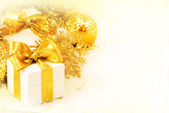 Gift box with golden ribbon Royalty Free Stock Image