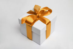 Gift box and golden ribbon Stock Image